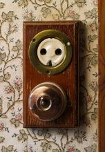 Electric light switch and socket in the Maids' Bedroom at Nunnington Hall, North Yorkshire