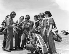 WASP pilot trainees listen to the instructor as he demonstrates aerial maneuvering. WASP pilots remain largely unrecognized to this day despite their keen and dedicated contribution to the war effort in WW2.
