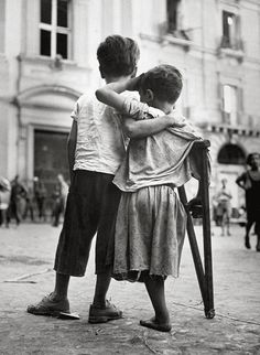 Boy Helps Amputee Friend Injured in War in Naples, Italy by Henri Cartier Bresson, 1944