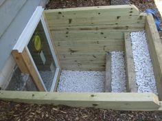 egress window for basement. just like this with different rocks