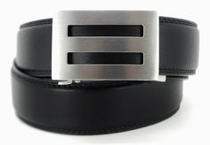 A new kind of belt for Men.  |  We got rid of the holes and replaced them with a hidden trak system.  The result >> a perfect fit every time.  Trakline Belts - Intrepid, $69.00 http://koreessentials.com