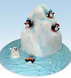 """Penguin's Playground"" Carved Iceberg Cake by Valerie Lindsley - This *cool* cake can herald a winter holiday, celebrate a ski trip, announce a special honeymoon or vacation, or just be a really fun cake for a fun occasion!"