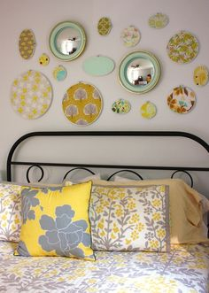 Mirrors and embroidery hoops above the bed - this might work well in the nursery too with some nice children's fabrics...