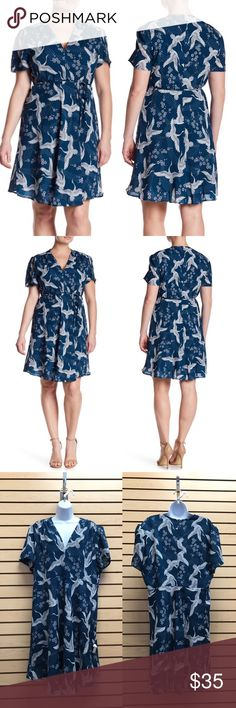 9b230eaf6f0 Glamorous Curves Heron Print Skater Dress A self-tie belt completes the  feminine look of