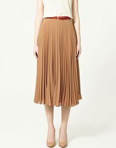 This floaty accordion-pleat skirt would be so breezy for summertime. (I love the way it's styled in this too!) From Zara.