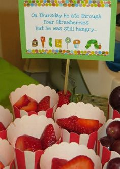Strawberries in striped cups at a Very Hungry Caterpillar Birthday Party!  See more party ideas at CatchMyParty.com!