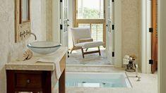 creamy walls surround a sunken Japanese soaking sunken tub in this master bathroom