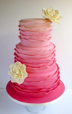 White chocolate pink ruffle cake with white chocolate roses | via Swirls Bakery