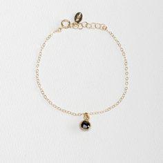 Onyx Drop Bracelet. Daintygold filled chain bracelet hangs a vermeil framed tiny faceted semi precious Onyx stone.  #Vilingdesigns #daintyjewelry #bracelets #womensfashion #style #jewelry #gold