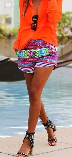 Patterned Shorts With Orange Blouse