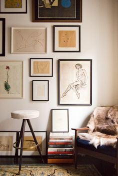 Distract from low ceilings by placing objects eye level and below; hang pictures slightly over half the wall, with interesting objects on the floor to help keep the focus down.