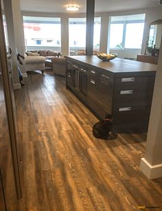 Niemann kitchen with Neolith island top, Legrabox, soft close drawer system and postbox type handles. Looking onto living areas.