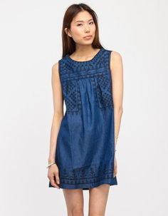 Indigo tank dress with paneled geo stitch patterning. Features textured embroidery, central pleat...