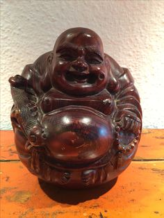 Happy Buddha in Teak. 20th cent. India.