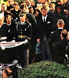 *JOHN F.KENNEDY FUNERAL:The body bearers folded the internment flag + Jack Metzer Sr.,Superintendent of Arlington National Cemetery presented it to Mrs. Kennedy....