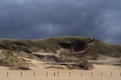 Beach at Julianadorp 2015. In the front the poles to stay out the Dunes. The sun won it from the clouds and gave us this beautiful pictures.