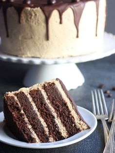 Chocolate Coffee Layer Cake Recipe ~ Chocolate cake and coffee buttercream topped with dark chocolate ganache... it\u2019s a guaranteed show-stopper. Cake for lovers #brownie #confectionery