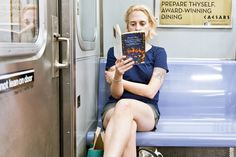 "Looks like a woman reading a her book and thinking back on what she did throughout the day on her way home.   UNYPL in 2012: Portraits - There is so much life underground, and I usually seek to incorporate it, along with the reader, into a storytelling frame. Sometimes though, a simple portrait of a reader seems to tell enough of a story; ""By Grand Central Station I Sat Down and Wept,"" by Elizabeth Smart"