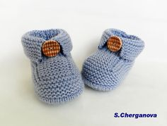 These are handmade baby slippers. The model is clean and simple. Used is baby acrylic yarn in interesting blue-gray color. They are decorated with wooden button. Christmas holidays are coming! You can make a warm and practical gift for your little baby!   Size - 3 - 6 months. Length of foot - 10.5 cm /4.1inches/  It is made ​​in a clean environment free from cigarette smoke or other odors and smells of clean and fresh  It is made especially for Etsy and it has never been washed or worn…