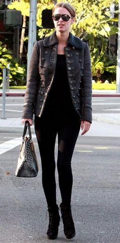 Look of the Day › December 2009 WHAT SHE WORE Hilton topped her slim black  separates with a military-style jacket and added a Goyard bag and YSL  booties ... 7b12bea231