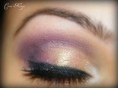 Pretty gold and purple eye makeup.