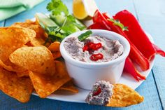 Refried Bean dip with corn chips and vegetables