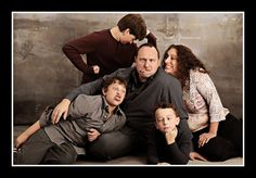 Studio B Portraits... Sure, this may not be the photo you place on the mantle, but it is one that will loosen up the gang and let everyone show their silly side!  Doesn't every family need one of these?