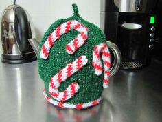 Another fun Christmas tea cozy.  http://knitting.about.com/od/christmaspatterns/ss/christmas-tea-cozy.htm