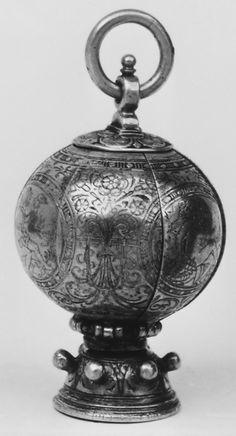 16th century German Pomander, Silver gilt  Dimensions: H. 2 5/8 in. (6.7 cm)  Accession Number: 32.75.45  Inscription: CANEL (cinnamon), MVSCAT (nutmeg) ROSMARIEN (rosemary), SCHLAG (?), WVRZ.N (gewürz nelke ?, clove) BERNSTEIN (amber).