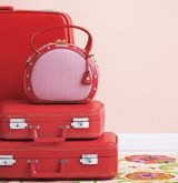 Red leather suitcases stacked