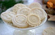 Springerle - German cookies with embossed mold designs. These are so beautiful. They almost look like pendants or large vintage buttons.