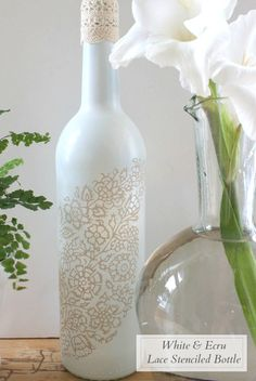 Transform an old wine bottle into a charming accent vase with spray paint.