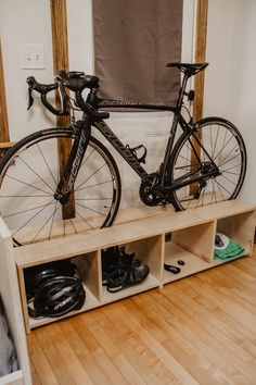 We built this DIY Standing Bike Rack for a single bike with lots of storage underneath! You can make this out of 1 sheet of plywood with our free plans! Wood Bike Rack, Diy Bike Rack, Indoor Bike Storage, Bicycle Storage, Bike Stand Diy, Standing Bike Rack, Garage Velo, Bike Storage Apartment, Bike Storage Solutions
