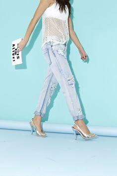 Awesome Shredded Jeans (www.nastygal.com/product/awesome-shredded-jeans/) and Elvis Is Alive Clutch (www.nastygal.com/product/elvis-is-alive-clutch)