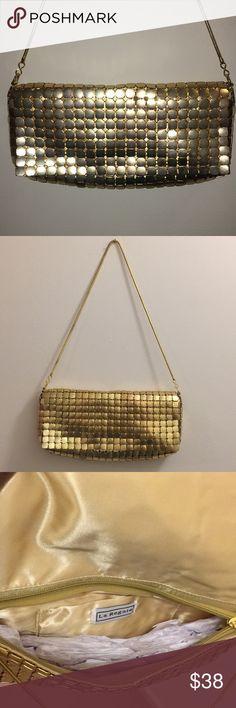Vintage La Regale Metal Mesh Handbag La Regale mesh metal handbag. Has chain strap. Zips up under the outside flap. Small inside pocket. Measures 10x5 La Regale Bags