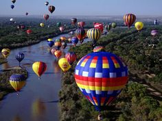 "International Balloon Fiesta at Albuquerque.  ""Each October, more than 500 colorful balloons take flight during early-morning mass ascensions at the International Balloon Fiesta, the largest such event and the most photographed event worldwide."" http://www.travelandleisure.com/articles/best-hot-air-balloon-rides/5"