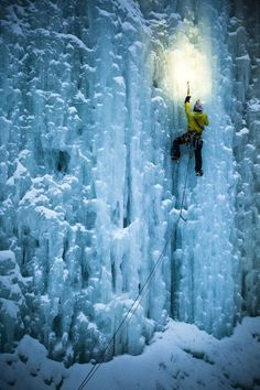 """After seeing the above photo on National Geographic's website under Extreme Photo of the Week, we knew we had to get in touch with the photographer to find out more. In that shot, climber Craig Pope is seen crossing an ice cave to a free-standing 82-foot-tall icicle without ropes or protection. Talk about extreme. On capturing that moment, photographer Ben Herndon told National Geographic, """"For this shot the real challenge was the constant dripping water from the icicles on the cave ceiling…"""