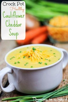 Crock Pot Cauliflower Cheddar Soup recipe- low carb version of classic potato soup- and easy healthy meal!  The best simple comfort foods made in the slow cooker.   | Running in a Skirt