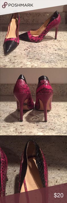Ivanka Trump Magenta and Black Python Heels These are a very comfortable classic style heel by Ivanka Trump. They are a magenta type color with black details... Python print. Only worn a couple of times. Size 8.5 Ivanka Trump Shoes Heels