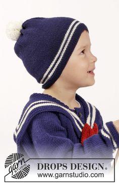 Sailor Aksel / DROPS Children 26-7 - Strikket jakke med raglan, løs matroskrage med sløyfe, strømper og lue med pongpong i DROPS Merino Extra Fine. Til barn i størrelse 2 - 10 år