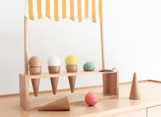 Fantastic Ice cream corner with 5 refreshing flavor for the summerFrom wood and honey stripes awning it's compose by 5 ice cream and a spoon to play with it easilyMade in France