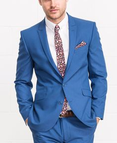 Blue suit with a floral touch in the tie and pocket square // ideal for a Summer Wedding // Groom ideas from Slater Menswear