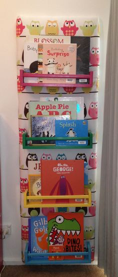My ikea spice rack hack, finally on the wall of Miss E's room for all her library books.   IKEA spice rack children's book shelf by Clair H