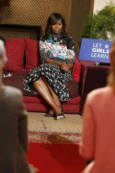 "June 28, 2016  As a part of her ""Let Girls Learn"" visit, Michelle Obama participates in a moderated conversation with Moroccan girls about education. She wore a multi-printed turtleneck dress and sheer black pumps for the occasion. AP"