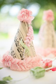 Wonderfully pretty birthday hats made from vintage sheet music and tissue paper. #crafts #birthday #party #DIY #hats #wedding #pink