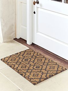 Doormats don't have to be dull! Our hardwearing coir doormat has a charcoal grey, Moroccan style pattern and durable rubber back to…