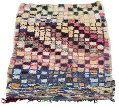 A gorgeous vintage boucherouite rug woven in scraps of used textiles, and deploying lovely deep and light pastel tones in a complex checkerboard pattern. For sale at Maroc Tribal