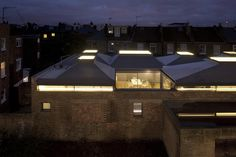 Vaulted House, a family house built on the walled site of a former taxi garage in Chiswick.