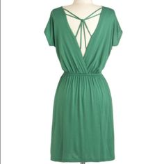 Gilli for Modcloth green jersey knit dress Adorable grass green casual dress with draped front and intertwined straps across the open surplus back.  Pleating at the elasticized waist, short dolman sleeves and pockets!  Worn only once. ModCloth Dresses