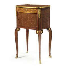 A fine Louis XV/XVI ormolu-mounted purplewood, tulipwood and parquetry table en chiffonnière circa 1770, stamped P. Pioniez the shaped rectangular top with outset corners and surrounded by an ormolu rim, the frieze veneered with Vitruvian scrolls and fitted with a drawer enclosing a writing surface and compartments above a tambour shutter opening to reveal three drawers, raised on cabriole legs fitted with ormolu chutes and sabots;